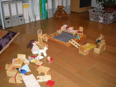 child therapy - exploring situations with dolls,  Kobe, Japan